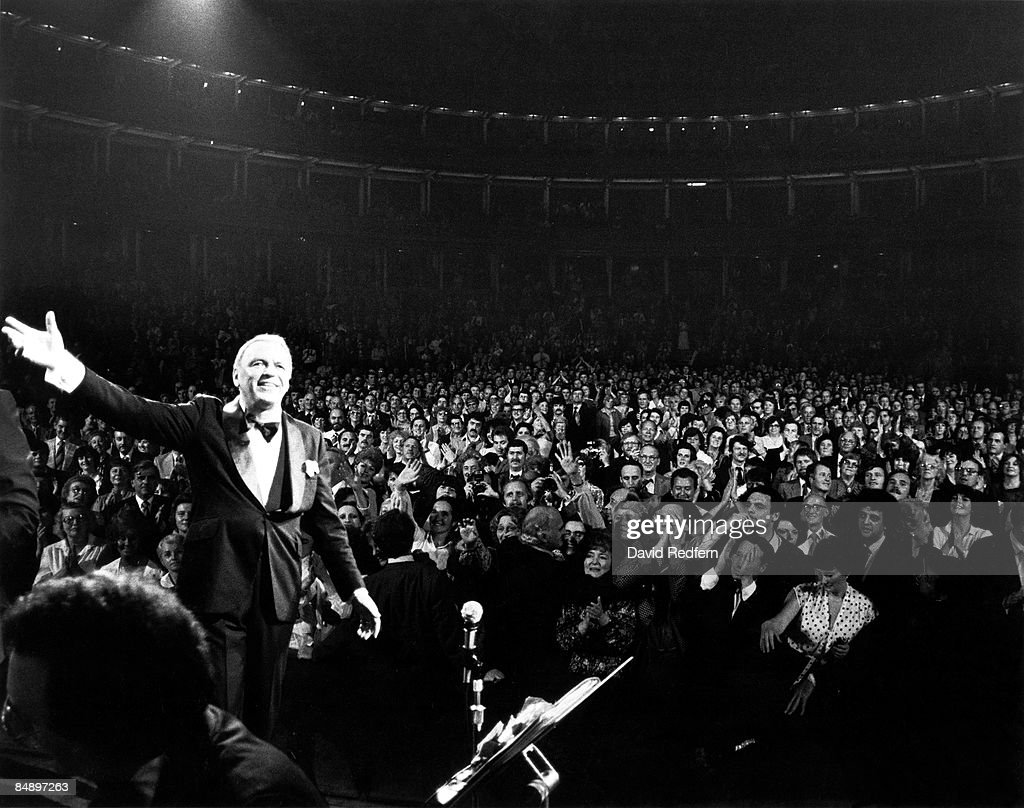 HALL Photo of Frank SINATRA, performing live onstage, waving with audience visible behind