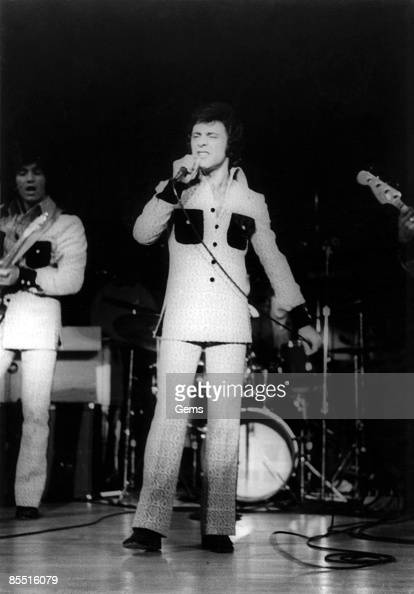 Photo of Frankie VALLI performing live on stage with the Four Seasons
