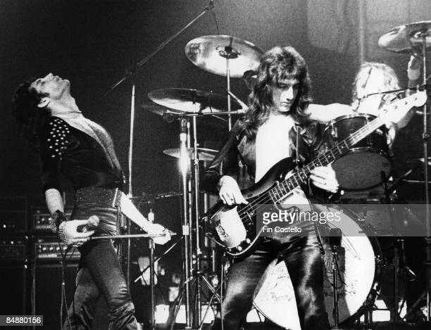 Photo of Freddie MERCURY and John DEACON and QUEEN Freddie Mercury and John Deacon and Roger Taylor performing live on stage