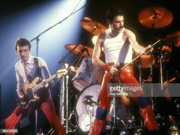 Photo of Freddie MERCURY and John DEACON and QUEEN John Deacon and Freddie Mercury performing live on stage at Groenoordhallen Lieden