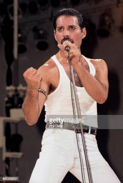 STADIUM Photo of Freddie MERCURY and LIVE AID and QUEEN Freddie Mercury performing live on stage at Live Aid