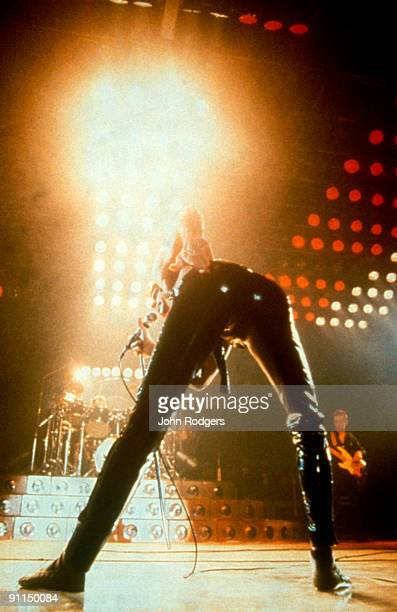 Photo of Freddie MERCURY and QUEEN Freddie Mercury performing live on stage leather trousers bending over
