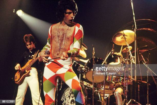 GARDEN Photo of Freddie MERCURY and QUEEN John Deacon and Freddie Mercury performing live on stage