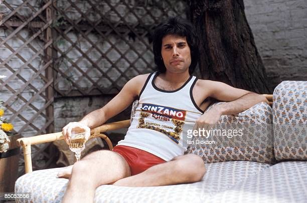 Photo of Freddie MERCURY and QUEEN Posed portrait of Freddie Mercury cinzano vest and shorts