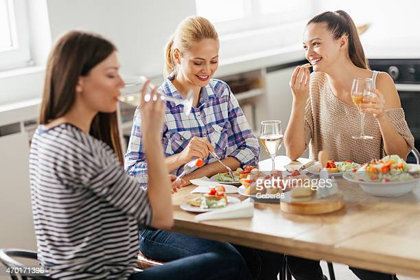 Photo of friends enjoying lunch together