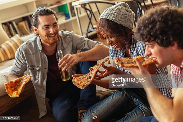 Photo of friends enjoying pizza at home