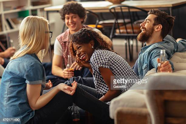 Photo of friends laughing and enjoying time at home