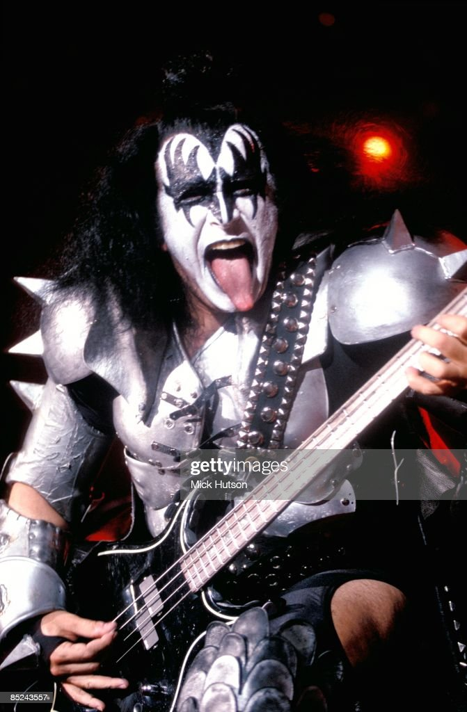 gene simmons tongue. arena photo of gene simmons and kiss, simmons performing live onstage, sticking tongue
