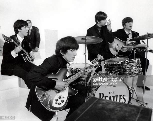 Photo of George HARRISON and BEATLES LR Paul McCartney George Harrison Ringo Starr John Lennon filming 'A Hard Day's Night' at Scala Theatre