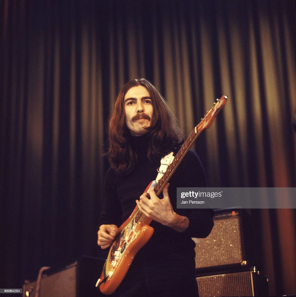 Photo of George HARRISON; performing live onstage with Delaney & Bonnie, playing 'Rocky' Fender Stratocaster guitar