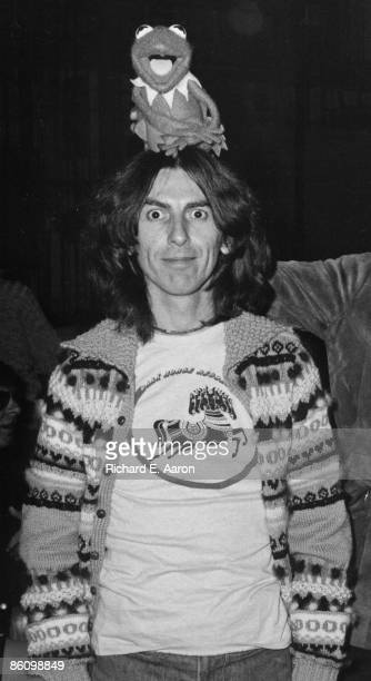 Photo of George HARRISON posed with Kermit The Frog at Saturday Night Live studios