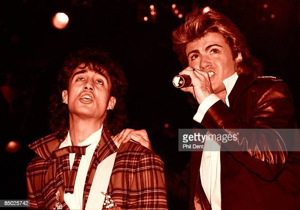 ARENA Photo of George MICHAEL and Andrew RIDGELEY and WHAM Andrew Ridgeley George Michael performing together live on stage