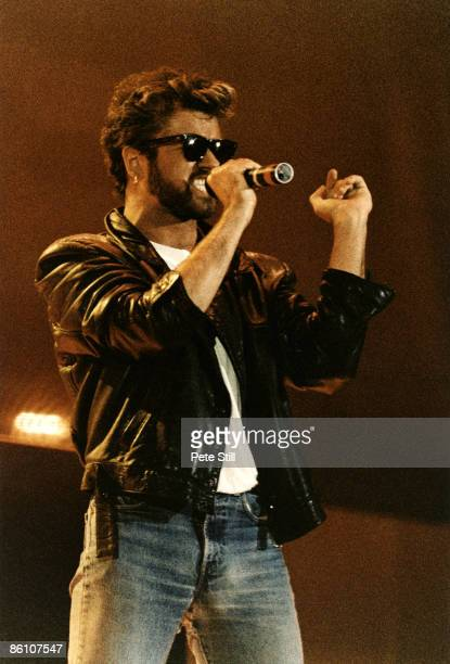 STADIUM Photo of George MICHAEL and LIVE AID and WHAM George Michael performing on stage at Live Aid