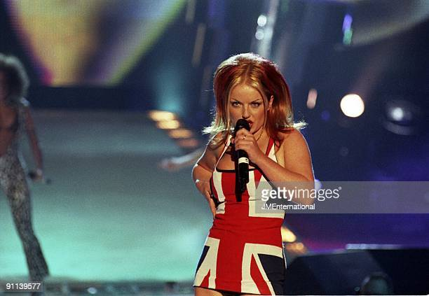 COURT Photo of Geri HALLIWELL and SPICE GIRLS Geri Halliwell performing live on stage Union Jack dress