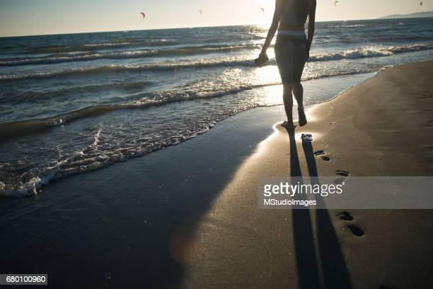 Photo of girl leaving footprint at the beach
