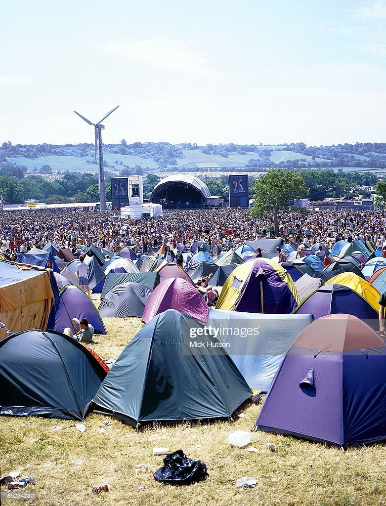 FESTIVAL Photo of GLASTONBURY, view of the main stage at Glastonbury Festival, showing tents, crowds and generator wind turbine