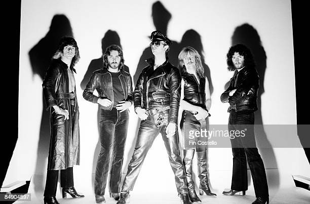 Photo of Glenn TIPTON and Ian HILL and JUDAS PRIEST and KK DOWNING and Les BINKS and Rob HALFORD Posed studio group portrait LR Glenn Tipton Ian Hill...