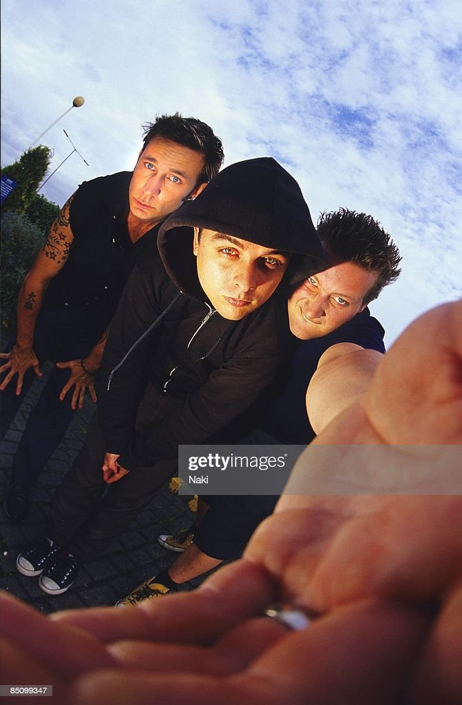 Photo of GREEN DAY and Mike DIRNT and Billie Joe ARMSTRONG and Tre COOL; Group portrait L-R Mike Dirnt, Billie Joe Armstrong and Tre Cool