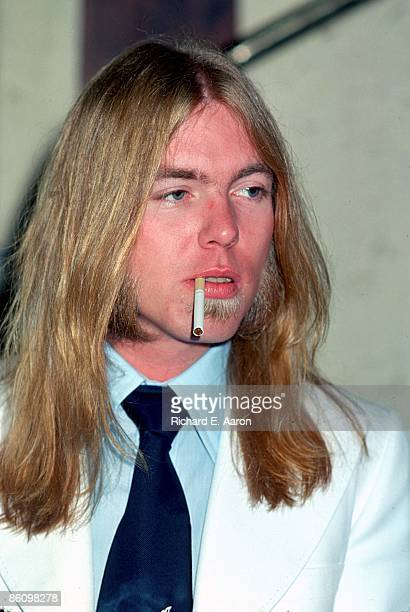 Photo of Gregg Allman from the ALLMAN BROTHERS posed smoking a cigarette in 1977