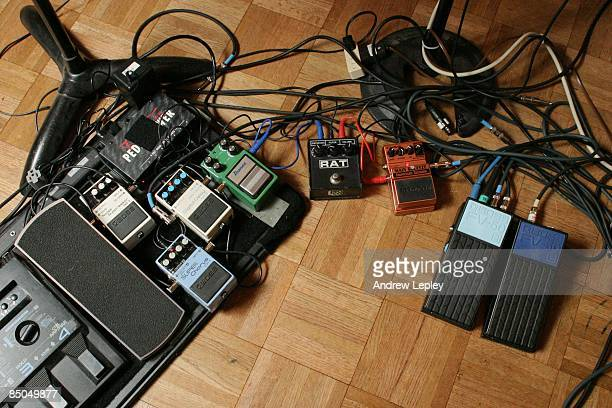 Photo of GUITAR PEDALS A selection of guitar effects pedals and leads on studio floor