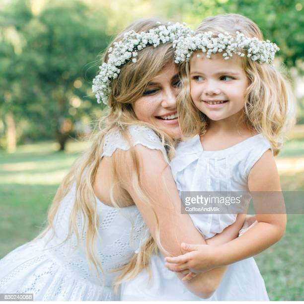 Photo of happy mother and her little daughter