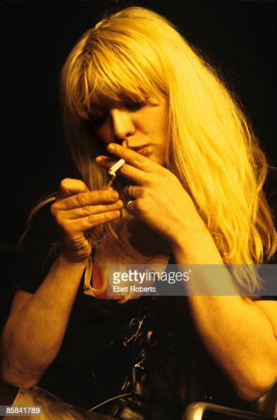 WEST Photo of HOLE and Courtney LOVE Courtney Love performing on stage at the Convention Center in Austin smoking cigarette