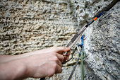 Photo of human's hand hammering up mountain during day