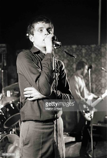 Photo of Ian CURTIS and JOY DIVISION Ian Curtis Peter Hook performing live onstage at Bowdon Vale Youth Club