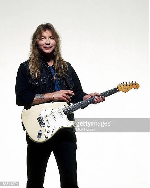 Photo of IRON MAIDEN and Dave MURRAY Dave Murray posed studio with Fender Stratocaster guitar