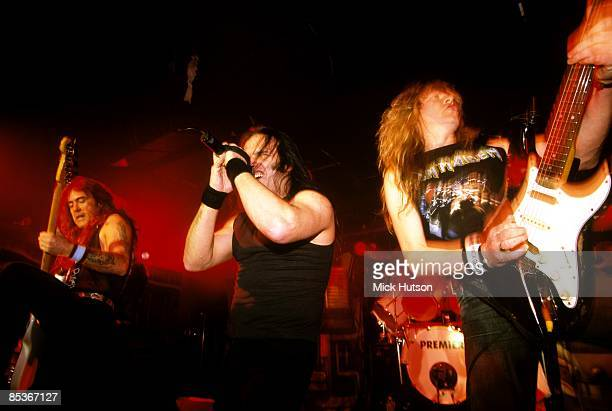 CITY Photo of IRON MAIDEN and Steve HARRIS and Janick GERS and Blaze BAYLEY with Blaze Bayley singing LR Steve Harris Blaze Bayley Janick Gers...