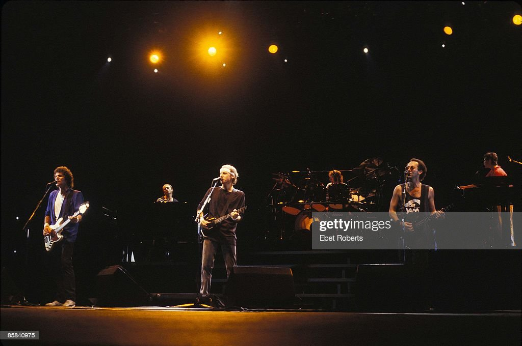 Photo of Jack SONNI and Terry WILLIAMS and Mark KNOPFLER and Alan CLARK and John ILLSLEY and DIRE STRAITS and Guy FLETCHER; L-R: John Illsley, Alan Clark, Mark Knopfler, Terry Williams, Jack Sonni, Guy Fletcher performing live onstage