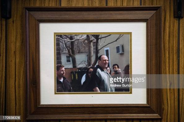 A photo of James Gandolfini playing the character Tony Sopranos while on set of the HBO show 'The Sopranos' hangs on the wall at Holsten's the...