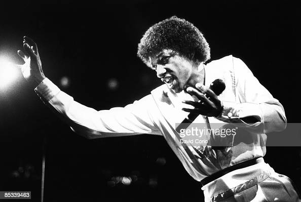 Photo of James 'JT' Taylor of KOOL THE GANG performing on stage early 1980s