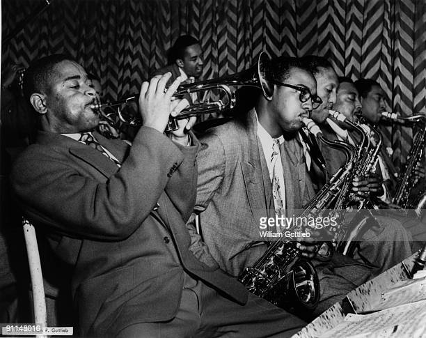 Photo of James MOODY and Dizzy GILLESPIE James Moody to Dizzy's left on saxaphone wearing spectacles