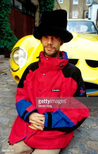 Photo of JAMIROQUAI and Jay KAY Jay Kaye with Ferrari car