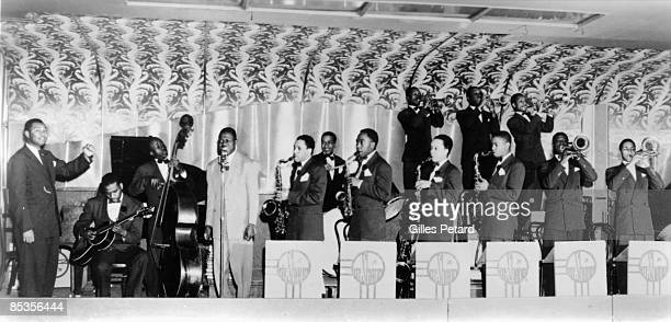 Photo of Jay Mc SHANN Jay McShann's band performing with Charlie Parker to the right of the drummer
