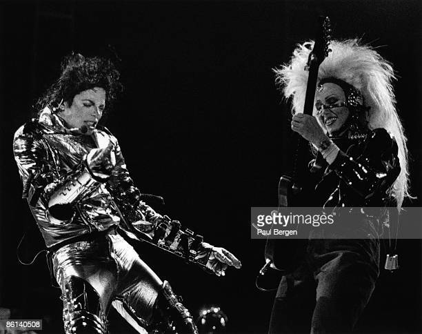 Photo of Jennifer BATTEN and Michael JACKSON Michael Jackson performing on stage at the Amsterdam ArenA with Jennifer Batten HIStory Tour