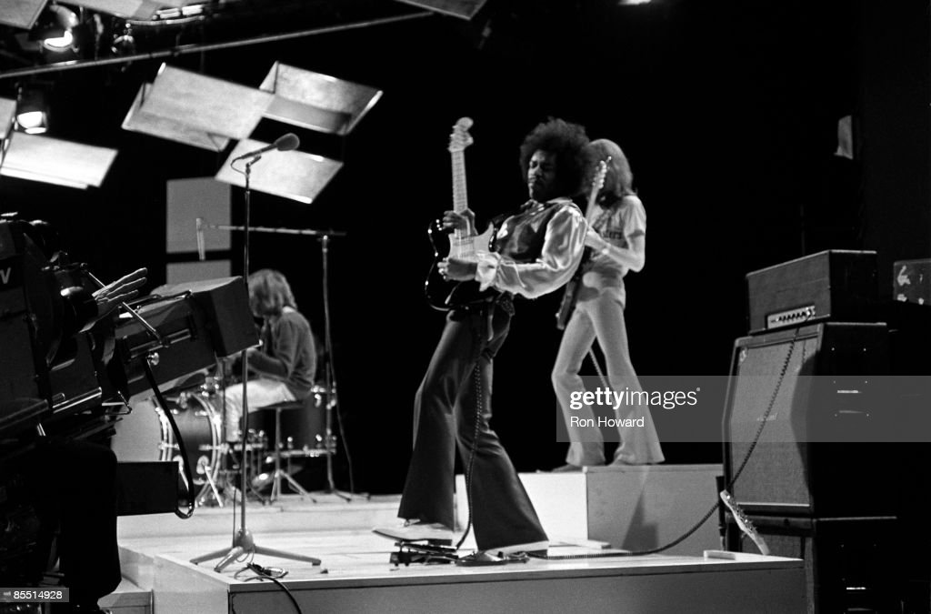 CENTRE Photo of JIMI HENDRIX EXPERIENCE and Jimi HENDRIX, L-R: Mitch Mitchell, Jimi Hendrix, Noel Redding (Jimi Hendrix Experience) performing on 'Happening For Lulu' TV Show, using wah-wah pedal
