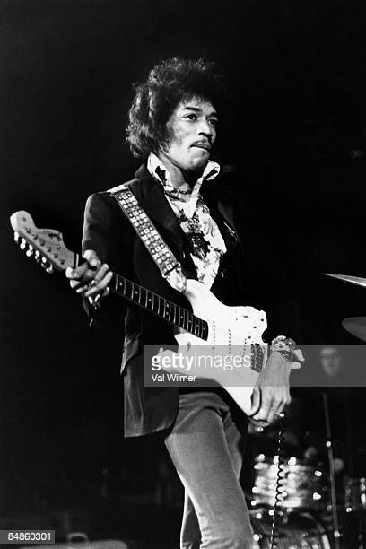 Photo of Jimi HENDRIX performing live onstage playing white Fender Stratocaster guitar