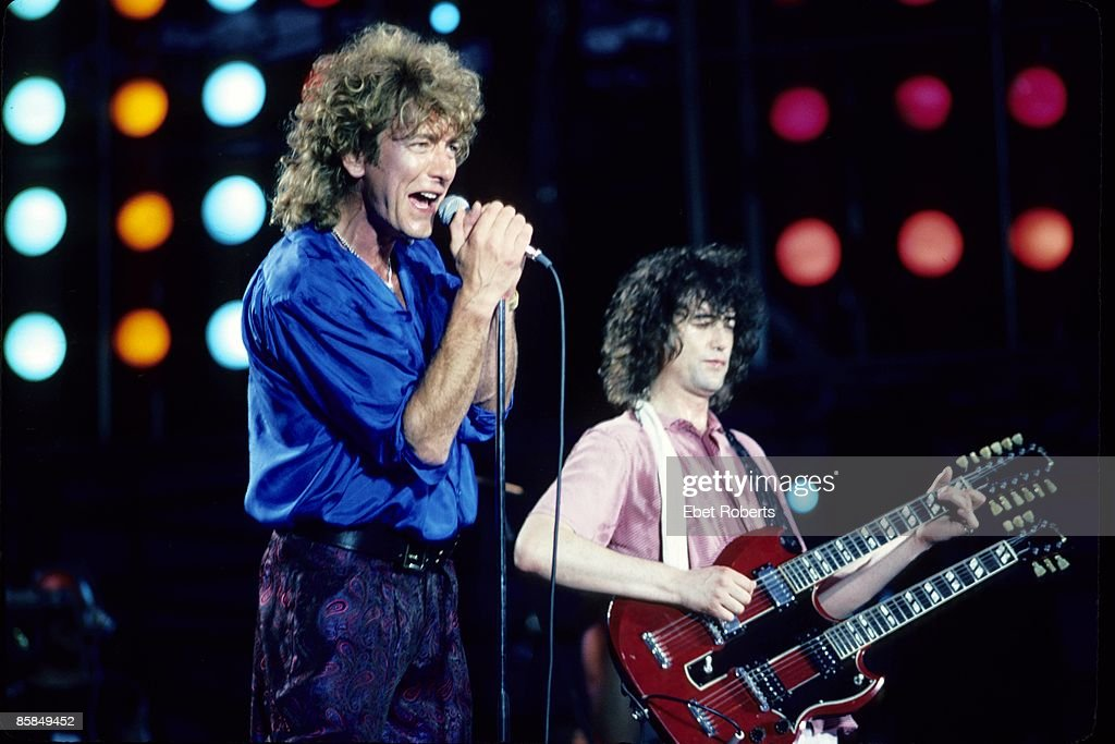 Photo of Jimmy PAGE and LED ZEPPELIN and Robert PLANT and LIVE AID; L-R: Robert Plant, Jimmy Page performing live onstage at Live Aid, Philadelphia