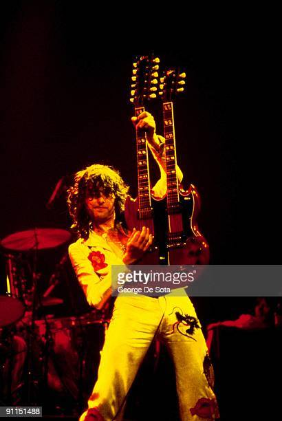 GARDEN Photo of Jimmy PAGE and LED ZEPPELIN Jimmy Page performing live onstage Nearly full length shot holding guitar up playing Gibson EDS1275...