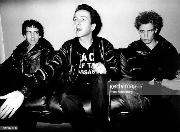 THEATRE Photo of Joe STRUMMER and CLASH and Mick JONES and Paul SIMONON LR Mick Jones Joe Strummer Paul Simonon posed backstage White Riot tour