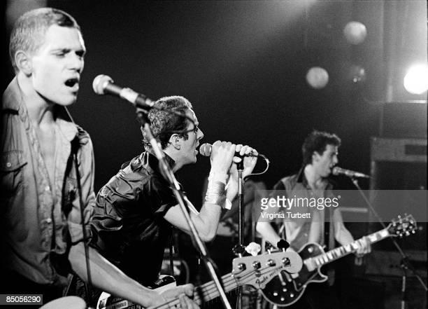PALAIS Photo of Joe STRUMMER and Paul SIMONON and Mick JONES and CLASH LR Paul Simonon Joe Strummer Mick Jones performing live onstage
