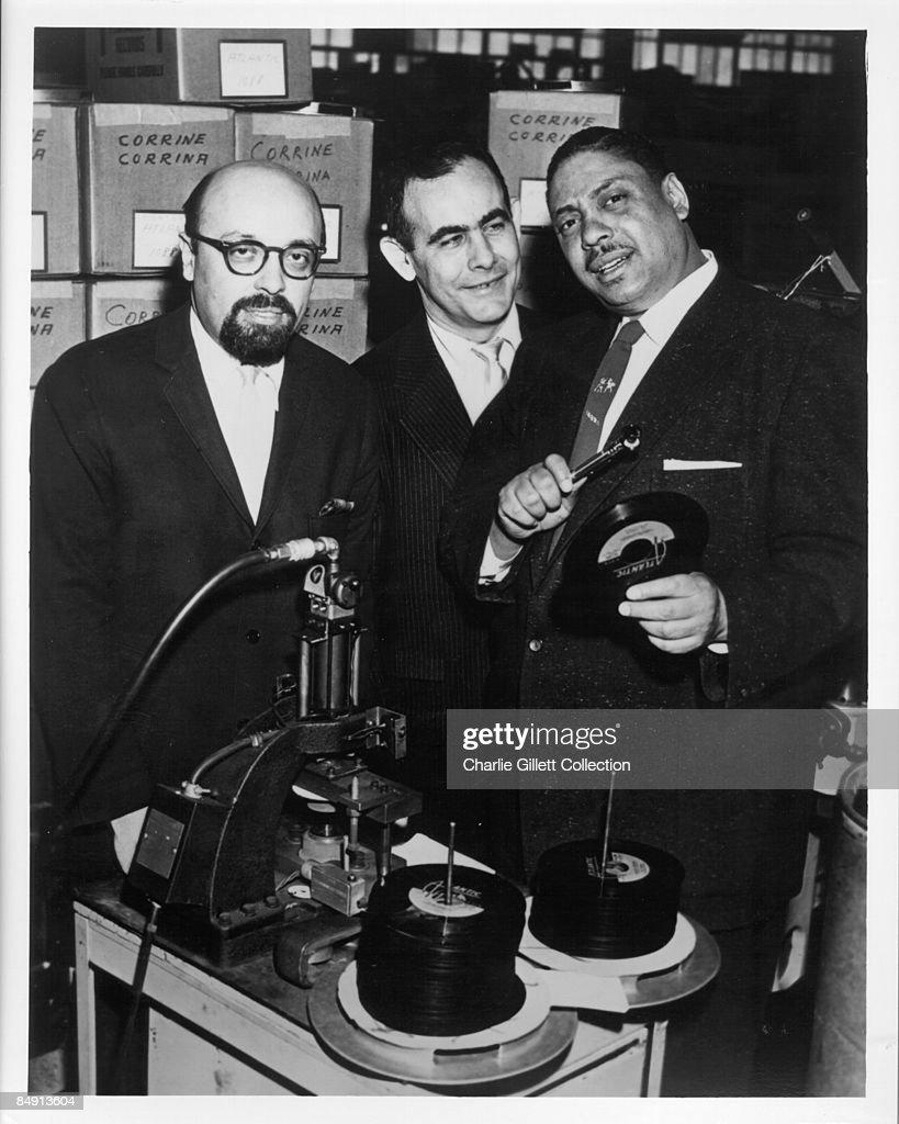 Ahmet Ertegun (founder of Atlantic Records), Jerry Wexler, Joe Turner, at the pressing plant, inspecting copies of Joe's new 45 'Corrine, Corrina'