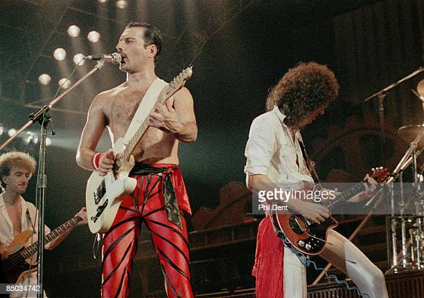 ARENA Photo of John DEACON and Freddie MERCURY and Brian MAY and QUEEN LR John Deacon Freddie Mercury and Brian May performing live on stage