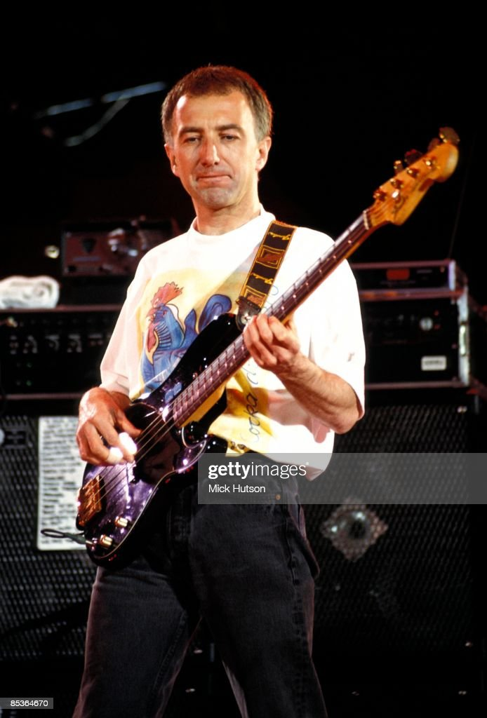 STADIUM Photo of John DEACON and QUEEN, John Deacon performing on stage at the Freddie Mercury Tribute concert