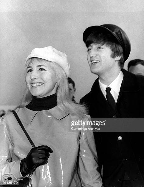 Photo of John LENNON and Cynthia LENNON while in The Beatles posed with his wife Cynthia at Heathrow Airport