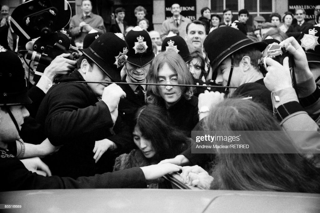 Photo of John LENNON and Yoko ONO and BEATLES; John Lennon and Yoko Ono, surrounded by the police, as they try to get in to a car to leave Marylebone Magistrates Court after appearing on charges of drug possession