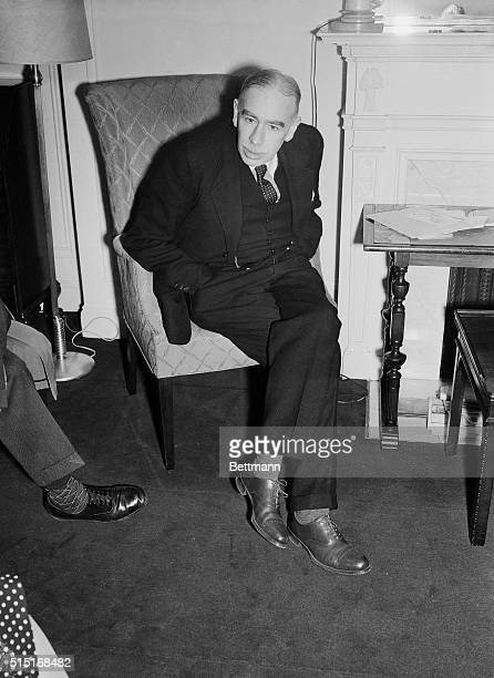 Photo of John Maynard Keynes the first Baron Keynes of Tilton and the son of John Neville Keynes shown seated with his hands in his pockets He is...