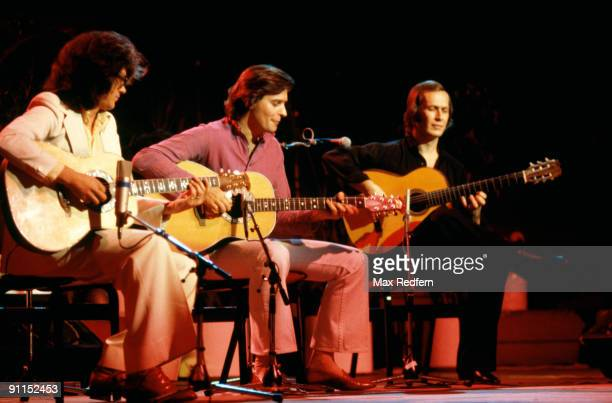 Photo of John McLAUGHLIN and Larry CORYELL and Paco De LUCIA LR Larry Coryell John McLaughlin and Paco de Lucia performing on stage sitting